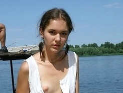 licentious young nymphomaniac shows  pussy in the Crimea on the beach