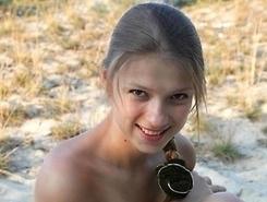 horny teen amateurs sunbathes fully naked on a nudist beach