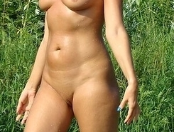 Nude Beach. Naked hottie having all kinds of fun